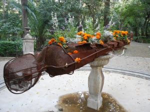 A friend walking his dog told me that this sculpture included a fountain filled will marigolds during the festival.