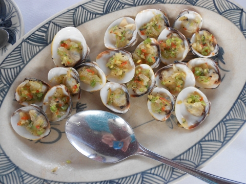 Just one of the many delicacies.  Clams prepared with herbs and garlic and a little chili.