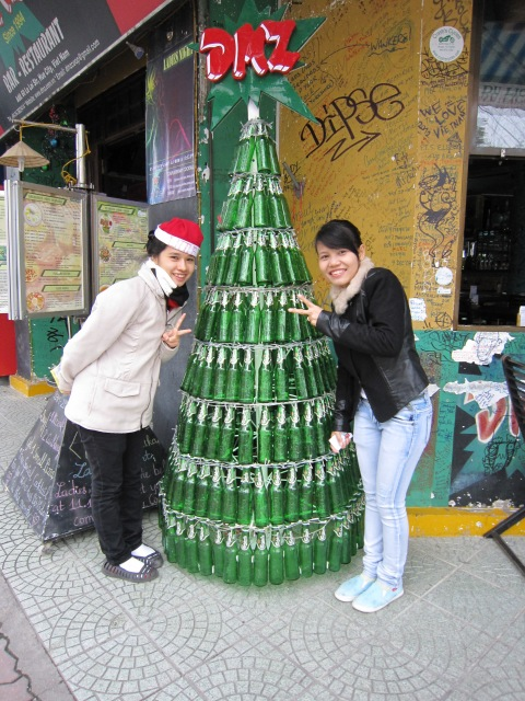 Young women at the DMZ bar, very happy to pose with their beer bottle tree.