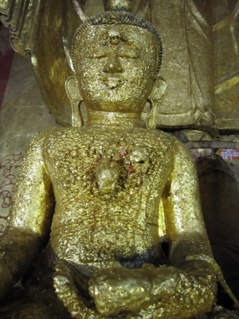 Buy a little gold leaf and stick it on the Buddha, for luck, for health.